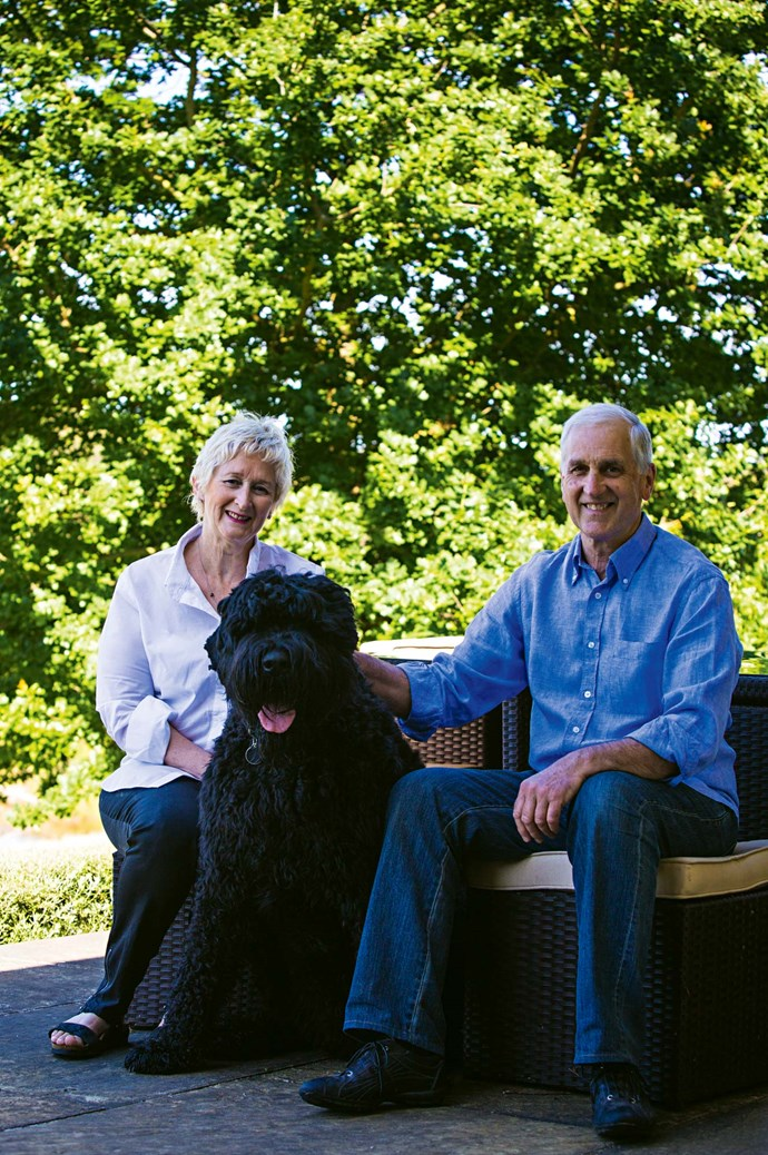 """Sue, Steve and Luther the Black Russian terrier. The Pates walk Luther around the lake several times a day, although they have to keep him away from the [beehive](https://www.homestolove.com.au/adding-a-bee-hive-to-your-garden-9890