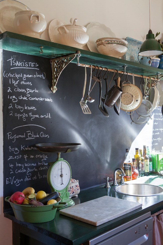 Recipes are written straight onto the chalk board splashback in the kitchen.  | Photo: Simon Griffiths