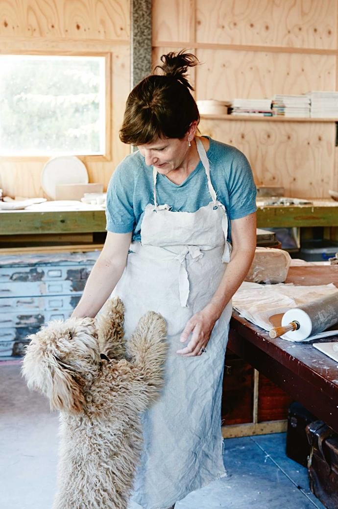 """Alison Fraser in her garage-turned-studio with the family dog, Daisy. """"It is my space,"""" she says."""