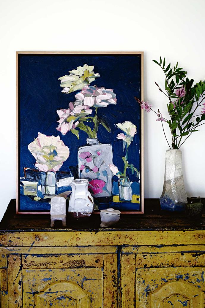 """Japanese vase and open roses, a painting by NSW artist Matilda Julian, sits on top of  a cabinet vintage cabinet. The ceramics are all Alison's apart from the chair by NSW central coast ceramic artist [Keiko Matsui](http://keikomatsui.com.au/