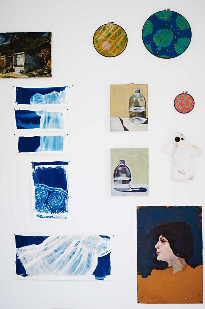"""The living room vignette is made up of (clockwise, from bottom left) some of Alison's cyanotype works, a landscape by artist Susan Robertson, circular overstitched fabric pieces from Planet, still-life bottle paintings by her friend Gillian Johnston and a """"love ghost"""" Alison gave to Andrew. The portrait was [a vintage find](https://www.homestolove.com.au/how-to-decorate-with-vintage-second-hand-finds-4673