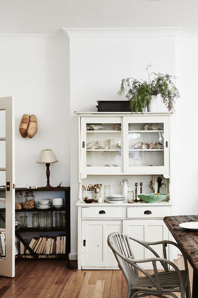 A mix of vintage, industrial and new pieces have been pulled together over the years to create the special character in the home. Kate's grandmother's lamp sits on the kitchen bookcase, which was rescued from the shed. The wooden clogs hanging above are from an op shop. | Photo: Lisa Cohen | Styling: Ruth Welsby