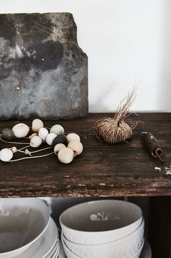 The recycled benchtop in the kitchen displays some of Kate's favourite things, including a string of wooden and clay beads from Tasmanian-based store, [Bellebird Handmade](http://bellebirdhandmade.bigcartel.com/). | Photo: Lisa Cohen | Styling: Ruth Welsby