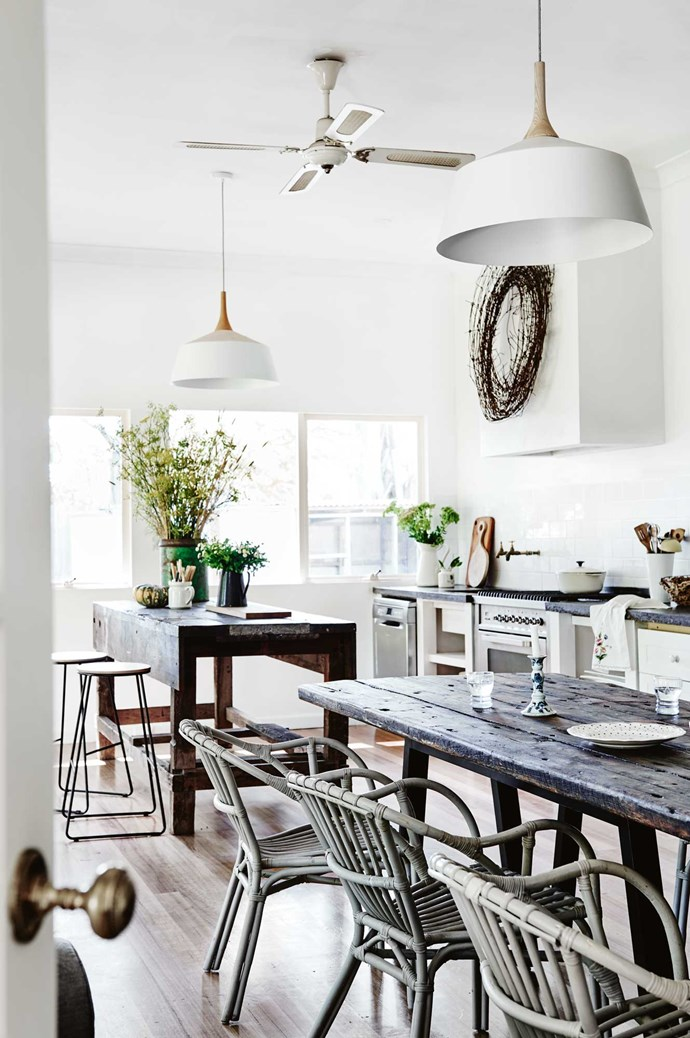 """A wreath that Kate made from rusty farm wire makes a focal point above the [concrete benchtop](https://www.homestolove.com.au/a-guide-to-kitchen-benchtop-surfaces-2444