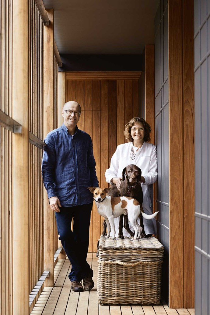Graeme and Penny with Harry and Coco in the walkway of the new wing.