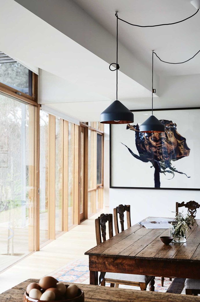A photograph of a flower by Isamu Sawa adorns the wall in the dining room. The 'Lloop' pendant lights were bought online at Vij5 from the Netherlands. | Photo: Sharyn Cairns