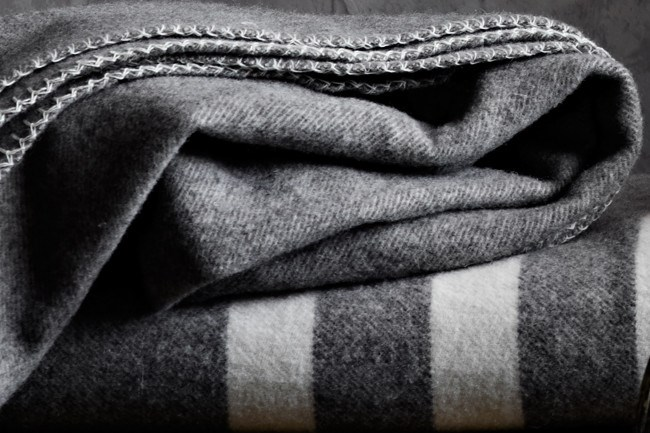 Wool 'Drift' blankets in rich grey tones to complement any home.  | Photo: Sharyn Cairns