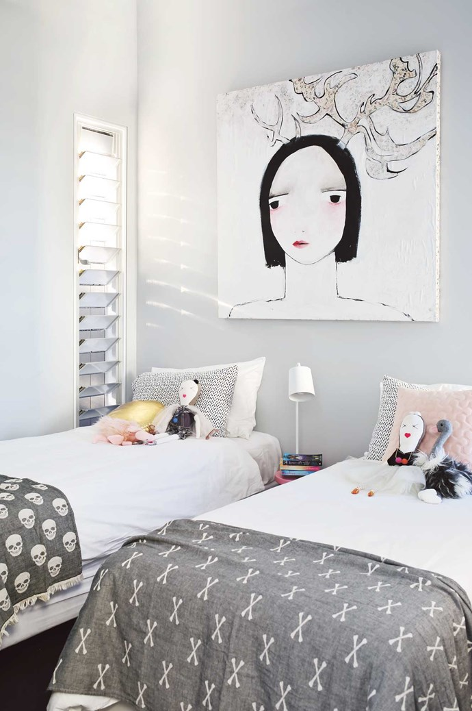Tip #7: If you want to keep the base of the room neutral, you can always give your kids free rein when it comes to the cushions and toys that go on the bed. While there are no kids living in this home, Brooke says there are a constant rotation of nieces and nephews. With that in mind, she's created something that has a neutral base and can be accessorised depending on who's staying! Just a pop of colour in the bedside table and in the artwork and bed accessories.  | Photo: Anastasia Kariofyllidis