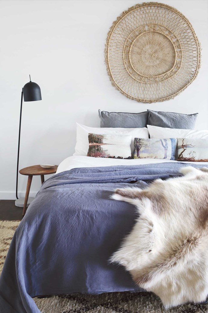 Tip #9: Use tactile artworks above the bed as a way to introduce another interesting texture to the mix. The cool soft grey and white walls of the bedrooms are in keeping with the rest of the home. Brooke has kept the mood warm by combining textures in bedlinen, throws, cushions, wall-hangings and rugs. Even in warmer climates, it's nice to have something soft underfoot when you jump out of bed.  | Photo: Anastasia Kariofyllidis