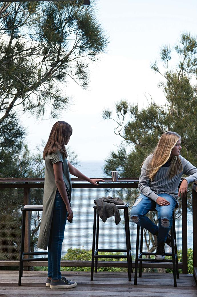 Sisters Ashleigh, 13, and Olivia, 12, admire the view from the deck.
