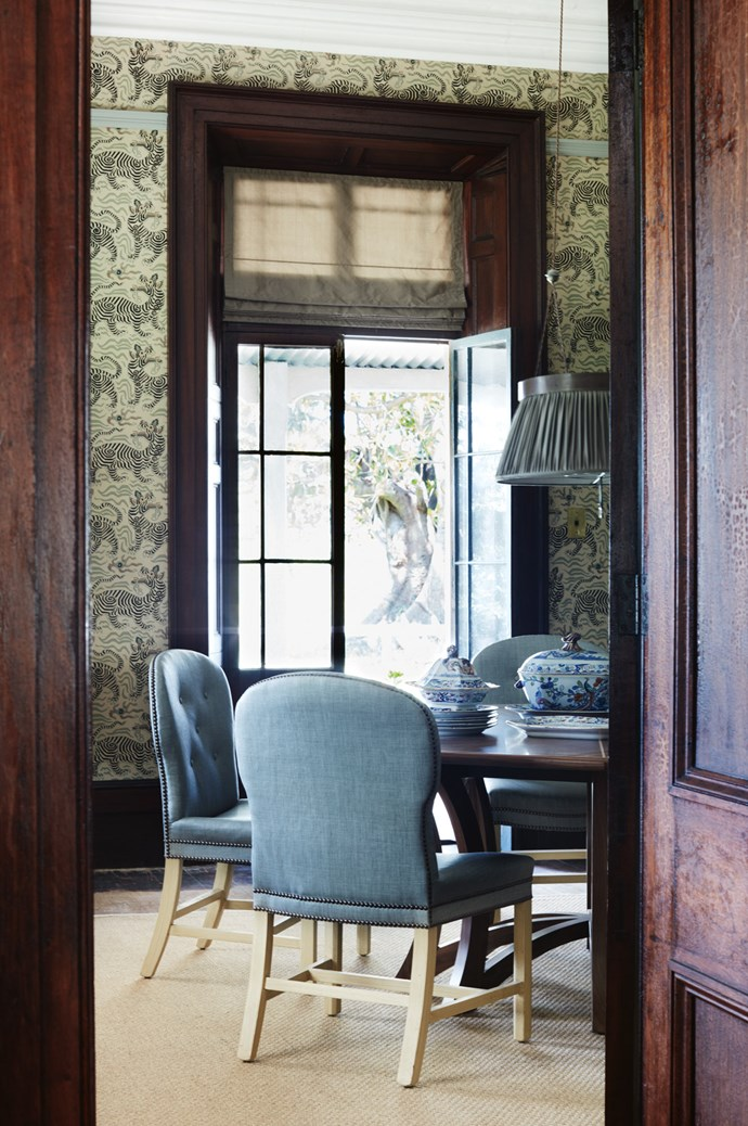 "The formal dining room features eight spoonback dining chairs and carvers, upholstered in [Holly Hunt](https://www.hollyhunt.com/|target=""_blank""