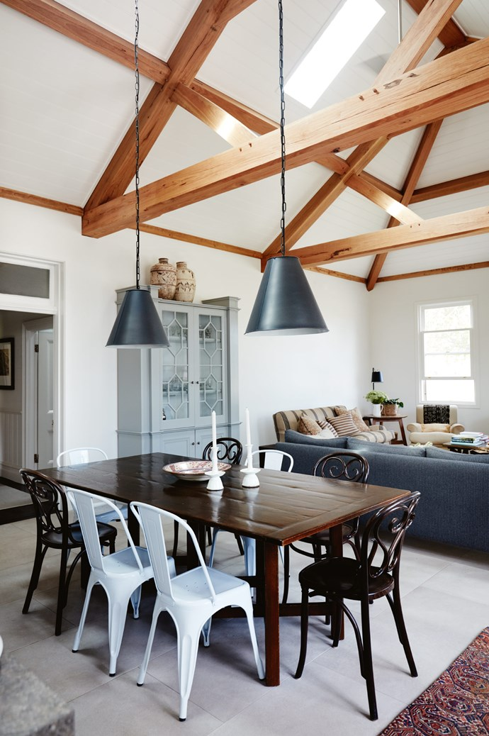 """A mix of vintage Thonet and Tolix chairs sit around the dining table from CDF Studio, Tamworth. The [pendant lights](https://www.homestolove.com.au/14-pendant-lights-that-pack-a-punch-2989 target=""""_blank"""") are from Visual Comfort."""