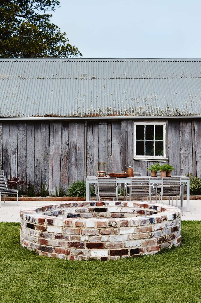 """Guests can get some sun on the swimming pool terrace, with the 'Extremis' outdoor table and chairs in teak and stainless steel from [Cult Design](https://cultdesign.com.au/). The original farm well was rebuilt in 2016 [using recycled bricks](https://www.homestolove.com.au/brick-statement-walls-19098 target=""""_blank"""") from the original kitchen chimney."""