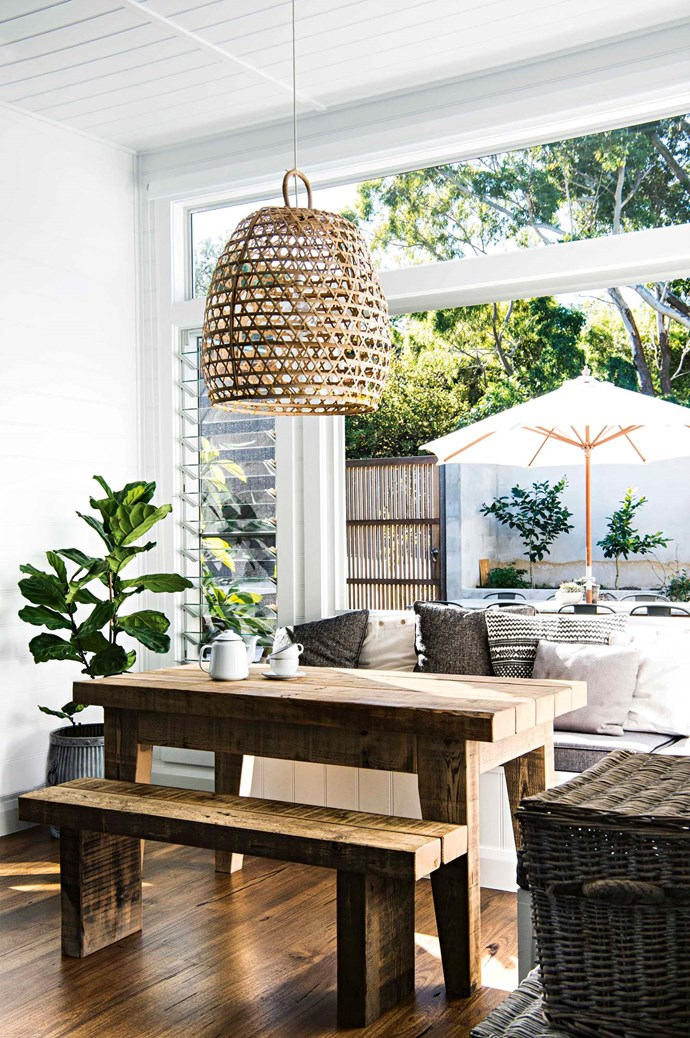 "The breakfast nook has folding windows opening out to the [courtyard deck](https://www.homestolove.com.au/balcony-and-deck-design-ideas-2458|target=""_blank""). David made the table bench from recycled timber. The cane pendant shade came from Leah's former homewares store."