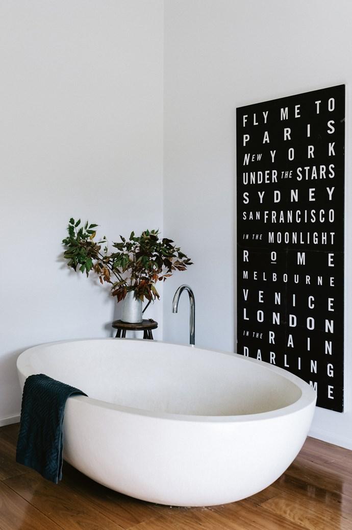 "A concrete [freestanding bath](https://www.homestolove.com.au/bathtub-buyers-guide-19347|target=""_blank"") makes a sleek statement in the bathroom."