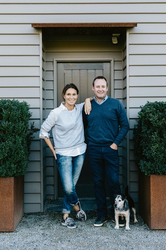Darren and Jospehine with Wally, the family's Jack Russell. The exterior of the home has been painted in Dulux Umbertone.  | Photo: Marnie Hawson