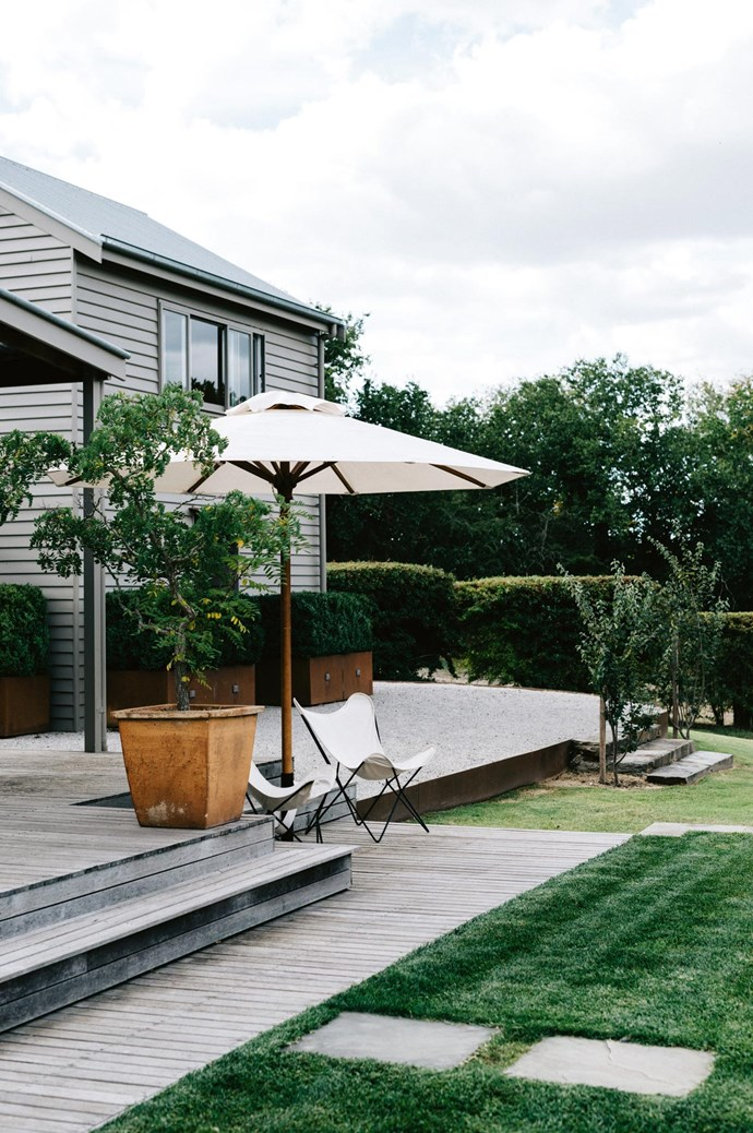 A spot to unwind on the deck at River House, with butterfly chairs from [Kabinett](http://kabinett.com.au/) in Kyneton. | Photo: Marnie Hawson