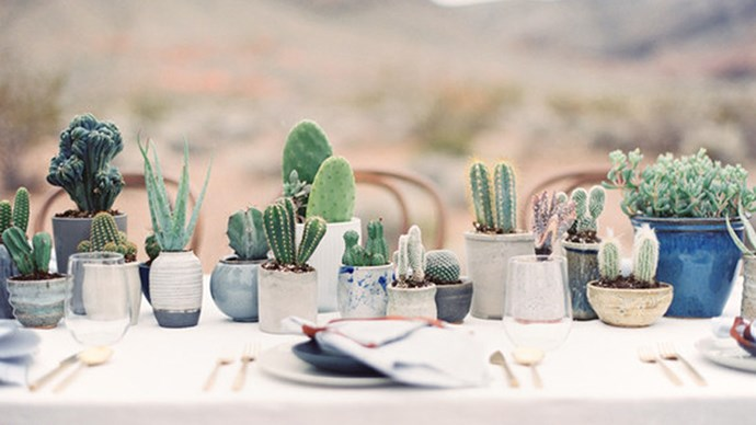 An assortment of concrete pots gives this neutral table setting a unique, handmade feel. Image via [100 Layer Cake](http://www.100layercake.com/)