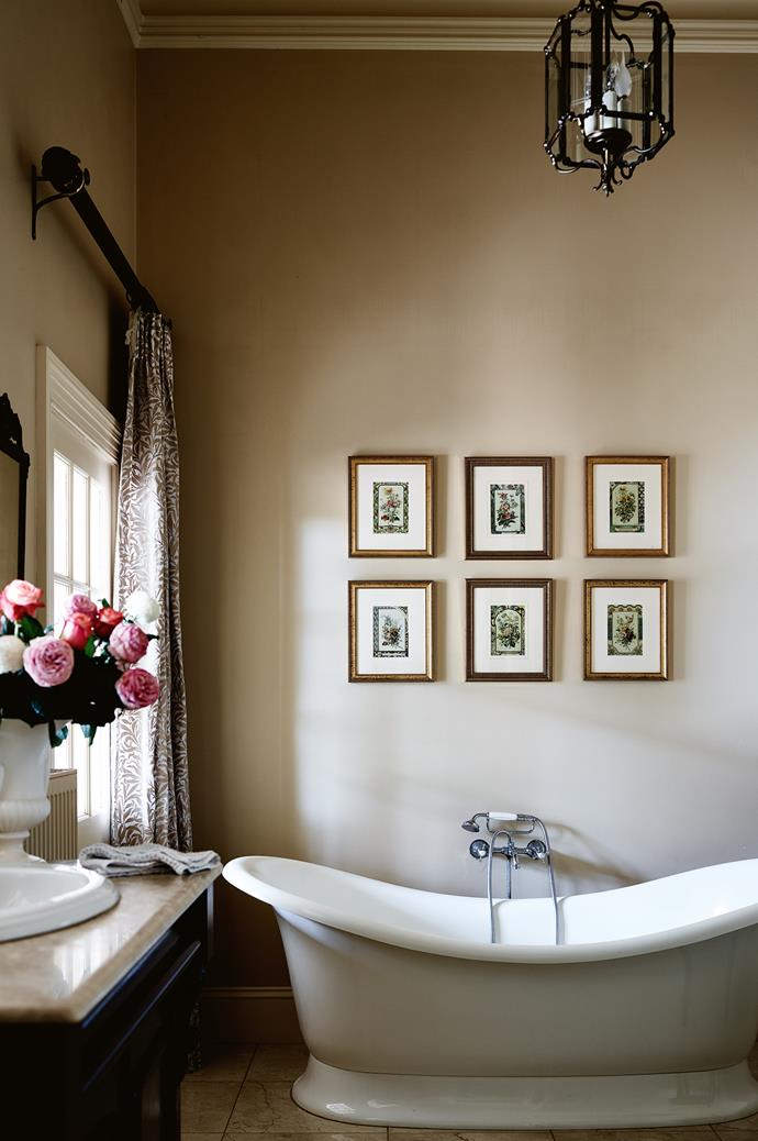 """William Morris fabric frames the window in the bathroom, where a freestanding Victoria and Albert 'Marlborough' bath from [English Tapware Company](https://www.englishtapware.com.au/
