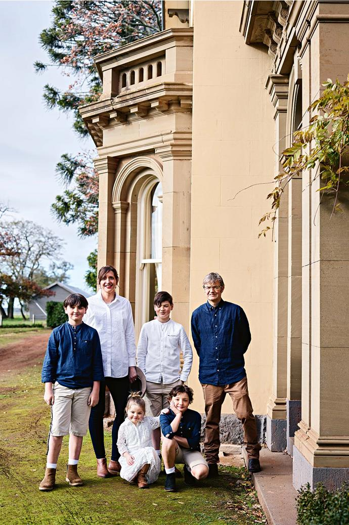 """Jane and Geordie with their children William and Edward (standing), Isobel and George. The family moved into the homestead after a year-long restoration in 2008. """"We came from Ballarat, as we needed space,"""" says Jane."""