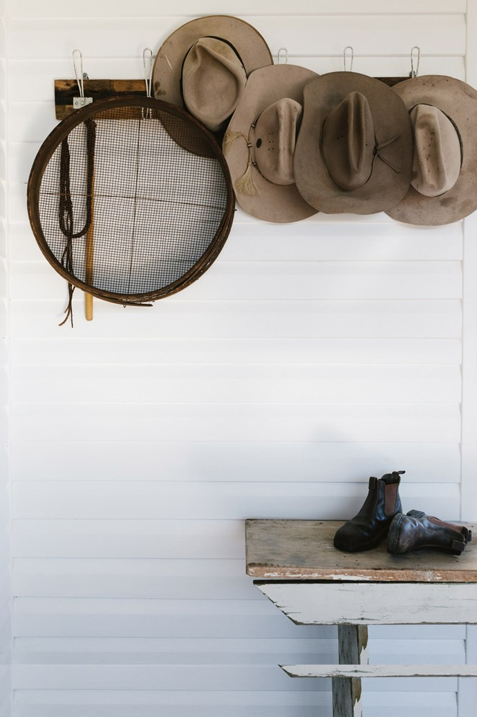 A sieve from Lulu and Jess hangs on the front deck, beside the family's hardy sun hats.  | Photo: Marnie Hawson