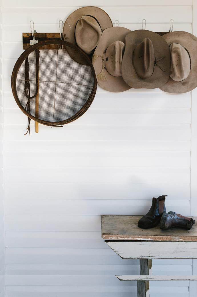 "A sieve from Lulu and Jess hangs on the front deck, which acts as a [mud room](https://www.homestolove.com.au/mudroom-design-6620|target=""_blank""), beside the family's hardy sun hats."