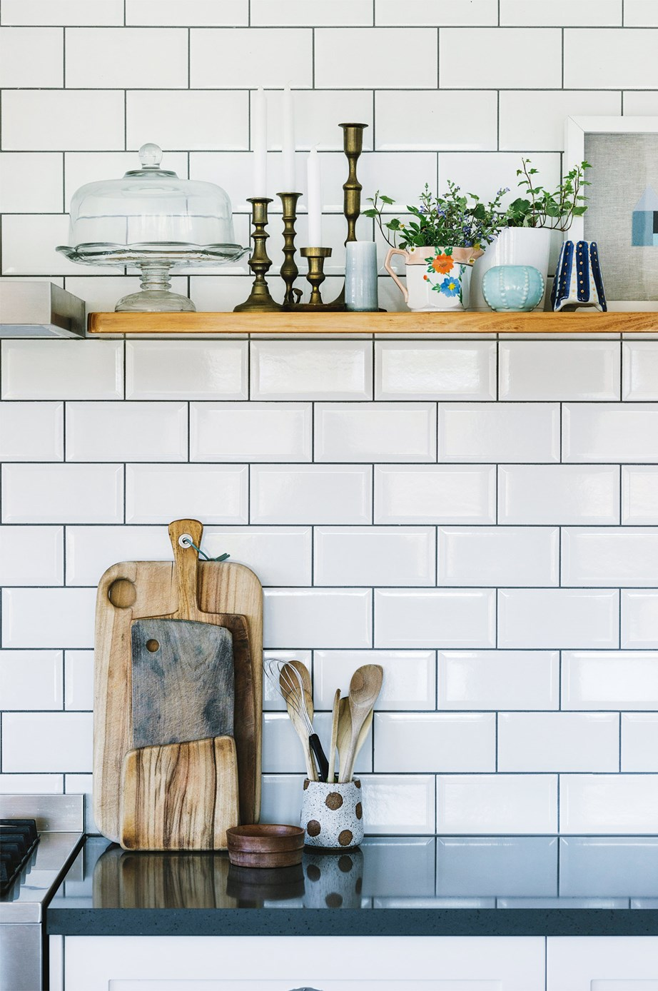 If you choose to replace your tiles, white subway tiles are a budget-friendly option that suit any style of kitchen.