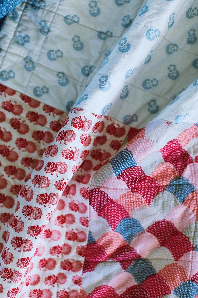 One of Susan's handmade quilts, which uses several fabrics, including 'Hipster Scallops' (bottom right) by [Riley Blake](https://www.rileyblakedesigns.com/), 'Marmalade' (bottom left) by Bonnie and Camille for [Moda](http://www.moda.com.au/) and 'Cabbages and Roses' (top). | Photo: Marnie Hawson
