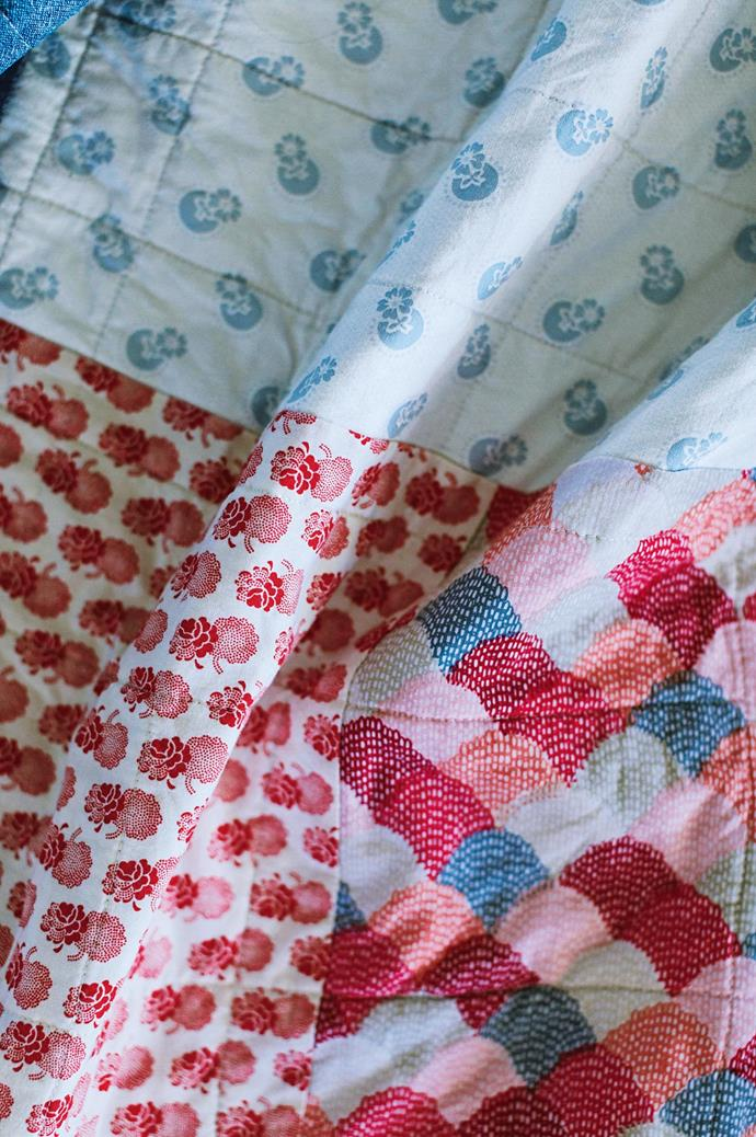 "One of Susan's handmade quilts, which uses several fabrics, including 'Hipster Scallops' (bottom right) by [Riley Blake](https://www.rileyblakedesigns.com/|target=""_blank""