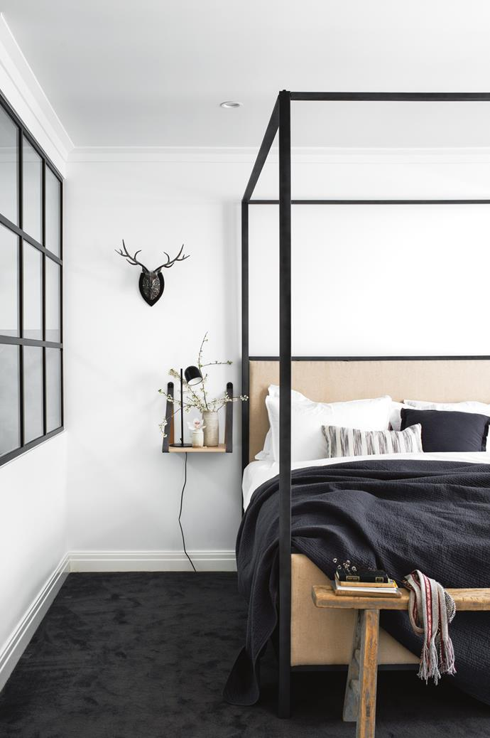 Daniel Mulligan ceramics adorn the main bedroom which adopts a minimalist modern-country aesthetic.
