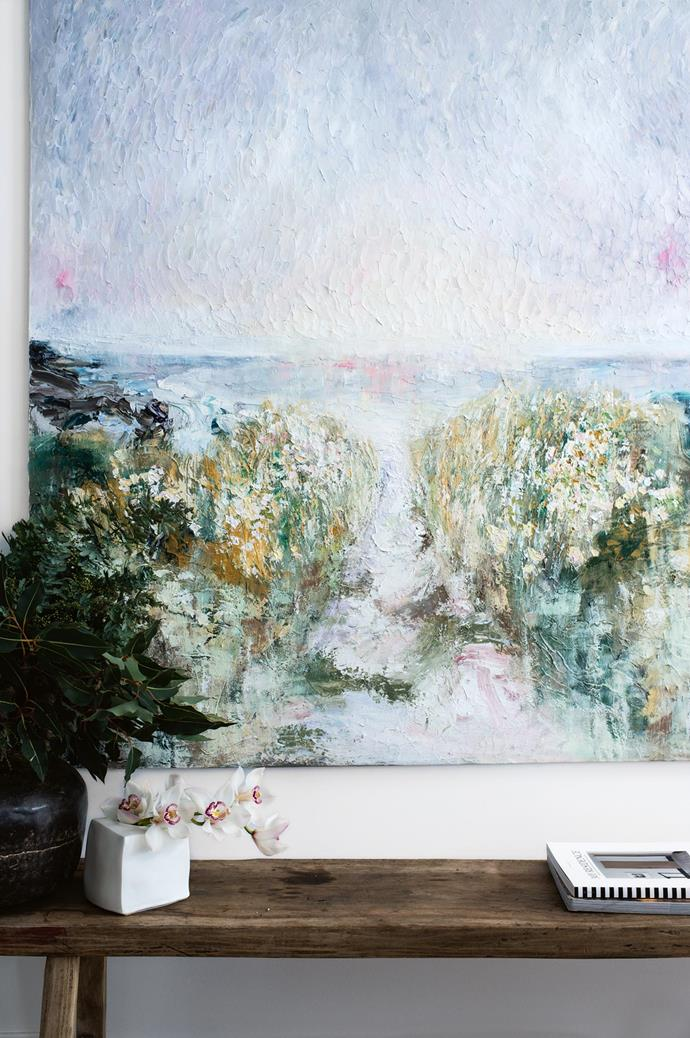 The artwork by Kasturi's sister is oil on linen and hangs above the sideboard in the living room.