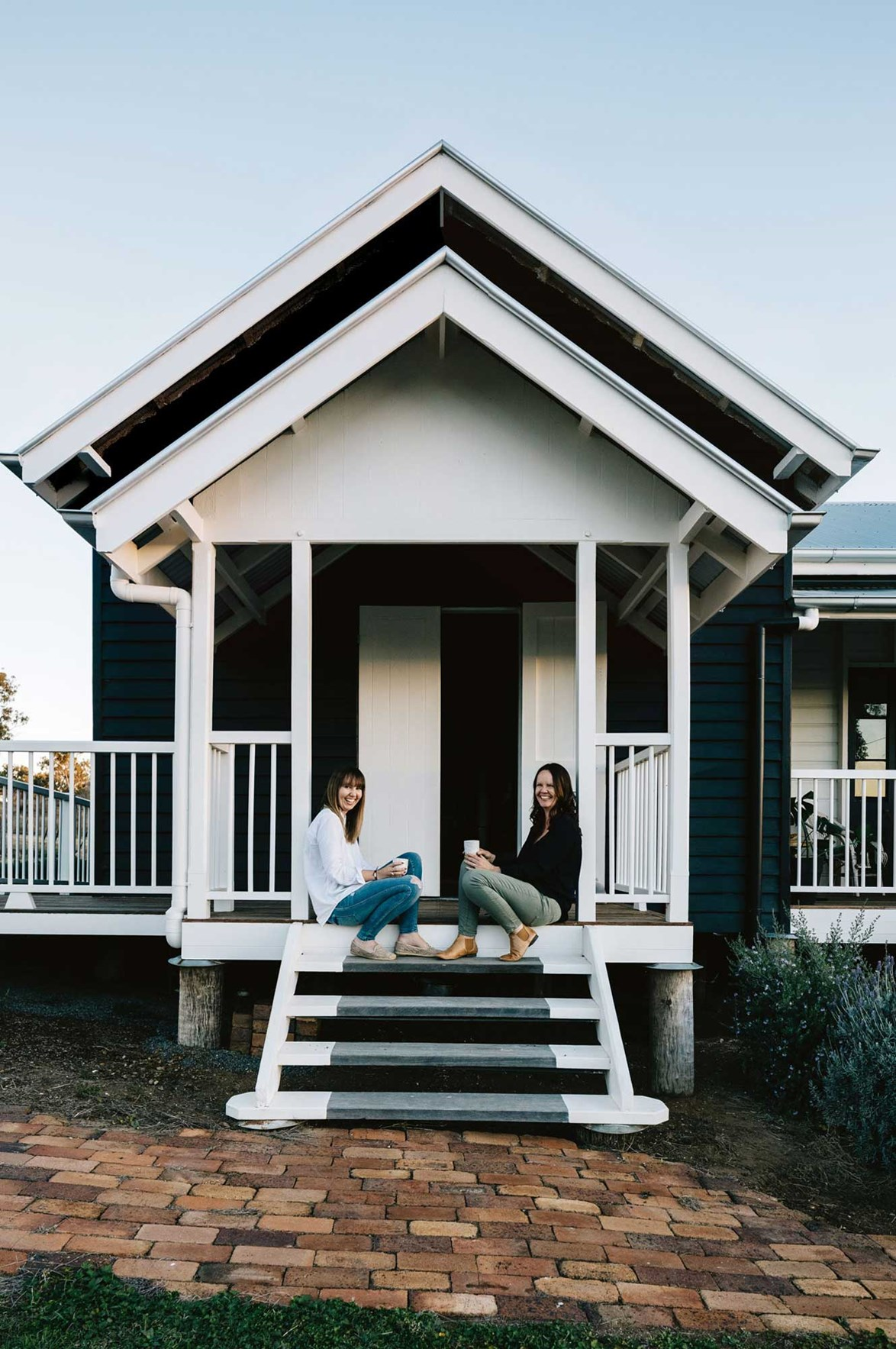 "[Renovating a former courthouse](https://www.homestolove.com.au/courthouse-home-conversion-13923|target=""_blank"") in Meringandan, Queensland, was a family project for mother-daughter pair Cathy and Kirstie Penton. ""We were worried someone would buy it and knock it down as it was in really bad disrepair,"" says Cathy. ""We didn't really have the money at the time but we thought why not? We knew it could be beautiful again."""
