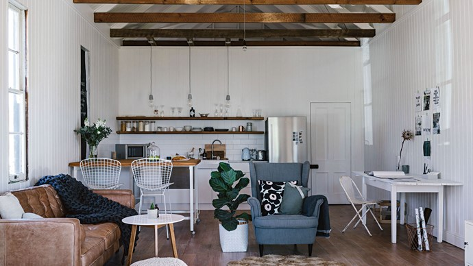 Renovating a former courthouse in Meringandan, Queensland, was a family project for mother-daughter pair Cathy and Kirstie Penton. Inside, original exposed beams were kept as a feature in the home, and give the space a sense of height and modest grandeur.