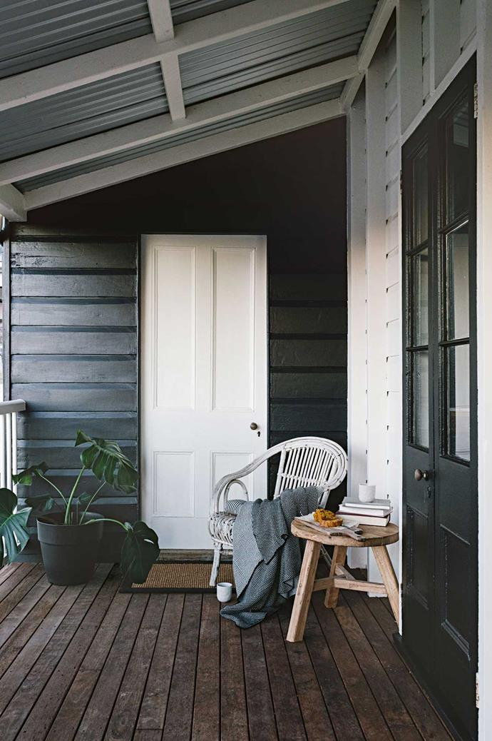 "A bold, [monochromatic colour scheme](https://www.homestolove.com.au/how-to-master-a-monochrome-decor-scheme-5867|target=""_blank"") gave an old weatherboard building and its welcoming verandah a new lease on life."