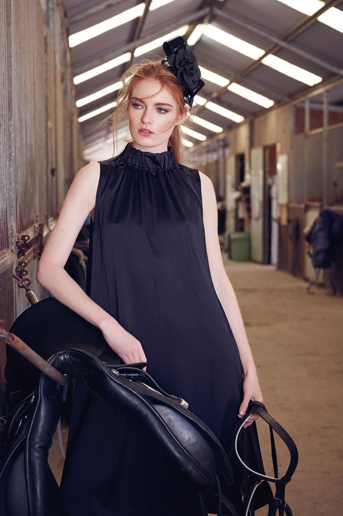 Patent and vinyl bow with raffia flower, $360, from Jane Lambert. High-neck silk dress in Black, $175, from [COS](www.cosstores.com/au/). | Photo: Corrie Bond