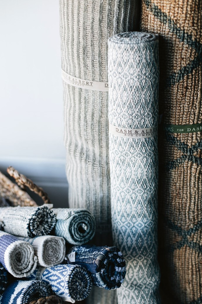 """A selection of Dash & Albert rugs and runners, including the 'Fair Isle Swedish Blue' cotton rug, 'Cut Stripe Ocean' wool rug and 'Marco Juniper' jute rug. The brightest colours usually sell to regional customers, whom Sarah believes """"like those pops of colour because they're always looking at a sunburnt country and a dry landscape.""""    Photo: Abbie Melle"""