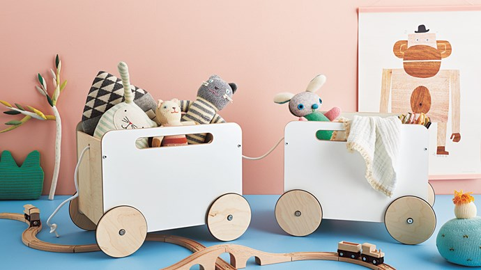 Blabla Kids 'Grass' pillow, $69.95, from [Can't Find It?](https://cantfindit.com.au/) 'Tea Tree' soft toy, about $138, from [Cocon](http://cocon.bigcartel.com/). 'Lillabo' train set, $9.99, from [IKEA](www.ikea.com/au/en/). Ooh Noo toy boxes, $229.95 each, from [Hello Little Birdie](https://www.hellolittlebirdie.com.au/). Lucky Boy Sunday 'Favourite Place House' pillow, $99.95, and Oyoy 'Peter Rabbit' cushion, $85, both from [Leo & Bella](https://leoandbella.com.au/). Blabla Kids 'Colette the Cat' soft toy (front), $69.95, and Blabla Kids 'Pepper the Cat' soft toy, $84.95, both from [Can't Find It?](https://cantfindit.com.au/) Maiike 'Bunny' toy, $89, from Koskela. Blanket, $79.95, from [Dove and Dovelet](https://www.doveanddovelet.com/). Walnut & Walrus 'Monkey' poster, $50, from [Leo & Bella](https://leoandbella.com.au/). Poster hanger, $45, from [Violet Eyes](https://www.violeteyes.com.au/). Oyoy 'Saki' hook, $38 a pair, from [Leo & Bella](https://leoandbella.com.au/). Blabla Kids 'Cactus' pillow, $79.95, from [Can't Find It?](https://cantfindit.com.au/) 'Endure' low-sheen paint in Rosedale Pink (wall), $65.80 for 4L, and Manly Harbour (floor), $65.80 for 4L, both from [Taubmans](www.taubmans.com.au/). All other items, stylist's own.   Photo: Brett Stevens