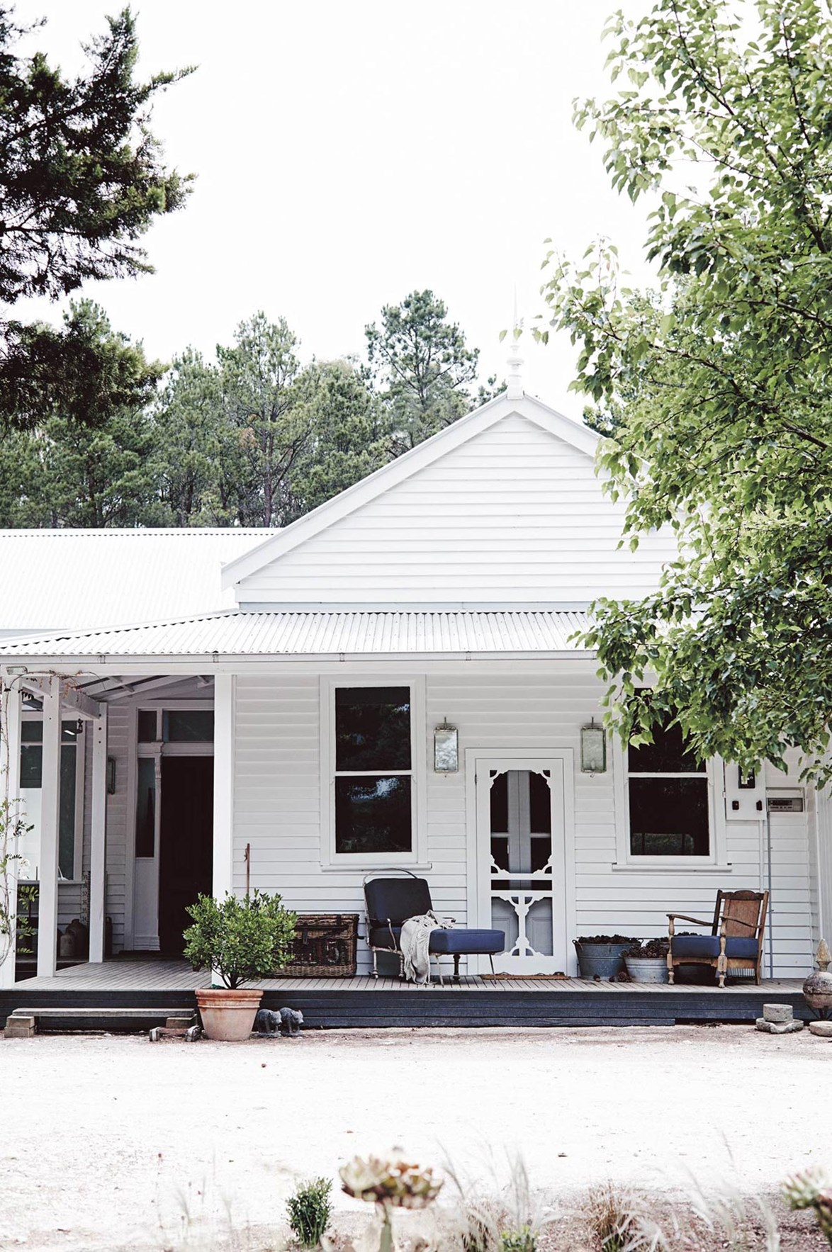The pretty, white-painted facade of horticulturalist Natasha Morgan's 1800s-era timber cottage in Spargo Creek, Victoria. The building was once a rural post office.