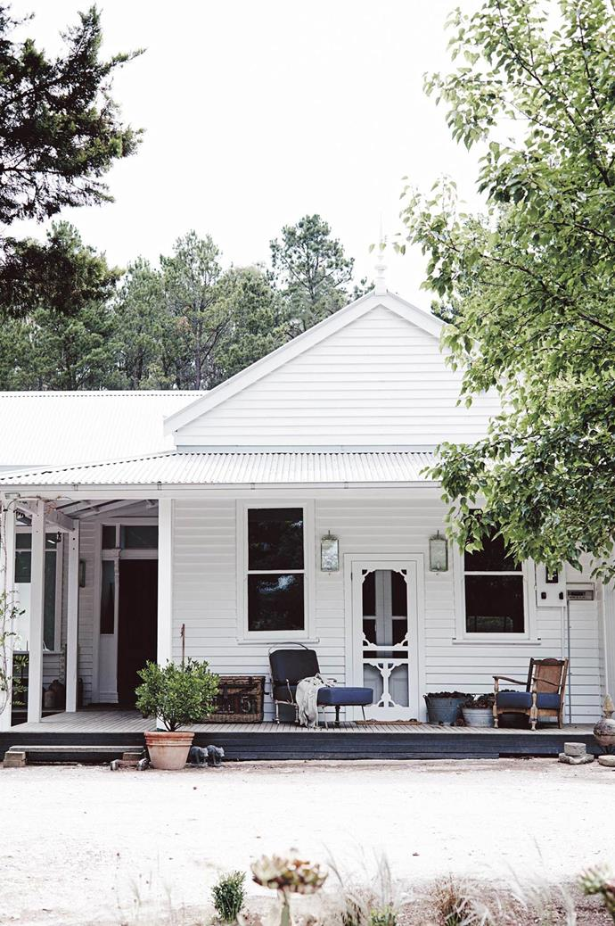 """The pretty, white-painted facade of horticulturalist Natasha Morgan's 1800s-era timber [cottage in Spargo Creek, Victoria](https://www.homestolove.com.au/french-inspired-country-home-in-spargo-creek-13750