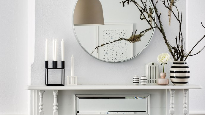 QUESTION: I have several  mantelpieces in  my house and I'm  running out of ideas  on how to style them. ANSWER: Your mantelpiece can set the tone for your entire room — make a statement with sculptural pieces, graphic prints and glossy ceramics. It's easy to allow clutter to build up on mantelpieces so stick  to a few key pieces. | Photo: Brigid Arnott