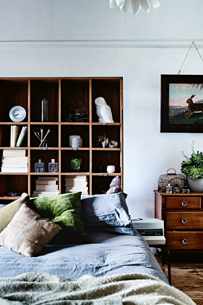 Pigeon hole shelves make a bedhead in the main bedroom. The hare painting is by one of Damien's ancestors and has been in his family for generations. The drawers belonged to his great-great-grandmother. | Photo: Mark Roper | Styling: Lee Blaylock