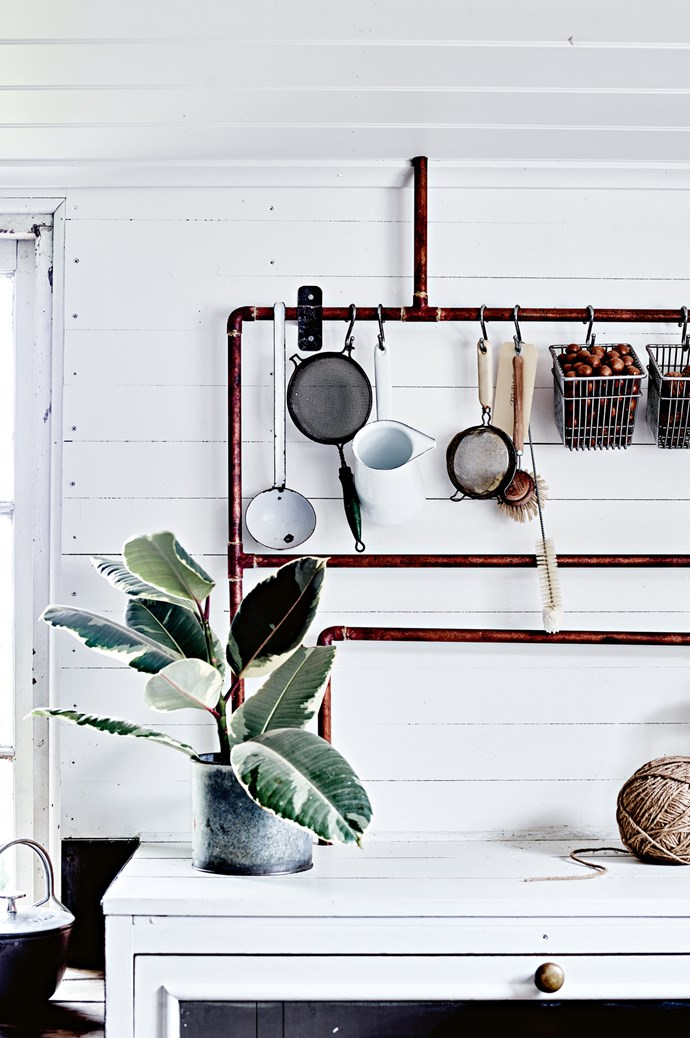 Copper water pipes act as a rack for kitchen utensils. The cupboard with drop down flywire doors was rescued from a local church hall. The ball of string is from [The Lost + Found Department](https://www.thelostandfounddepartment.com.au/). | Photo: Mark Roper | Styling: Lee Blaylock
