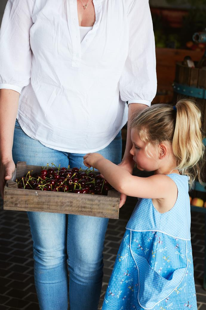 Amelie digs into a fresh box of cherries. Being able to pick and eat fruit straight from the tree is what makes the whole experience so special, Sophie notes.
