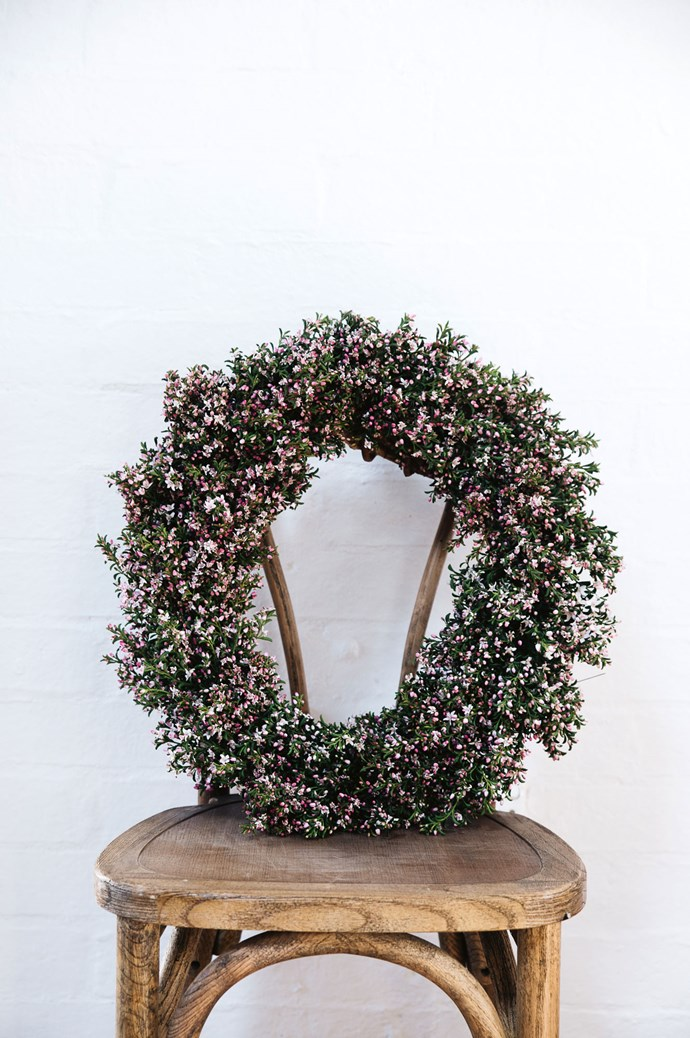 The family greet the festive season each year by adorning their home and shop with a wreath. This one is made of native eriostemon, also known as waxflower.  | Photo: Abbie Melle