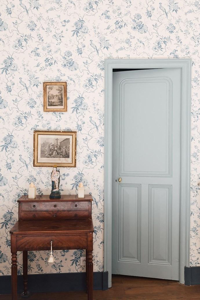 An antique desk sits against duck egg blue wallpaper.  | Photo: Annabelle Hickson