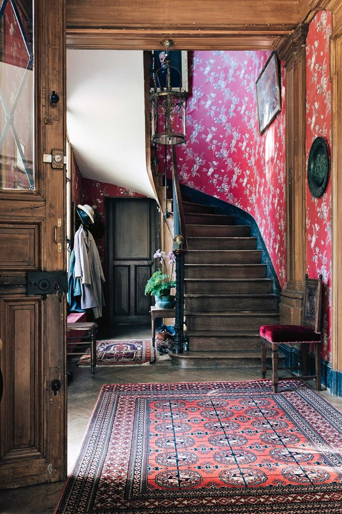 Handpainted wallpaper features in the foyer.  | Photo: Annabelle Hickson