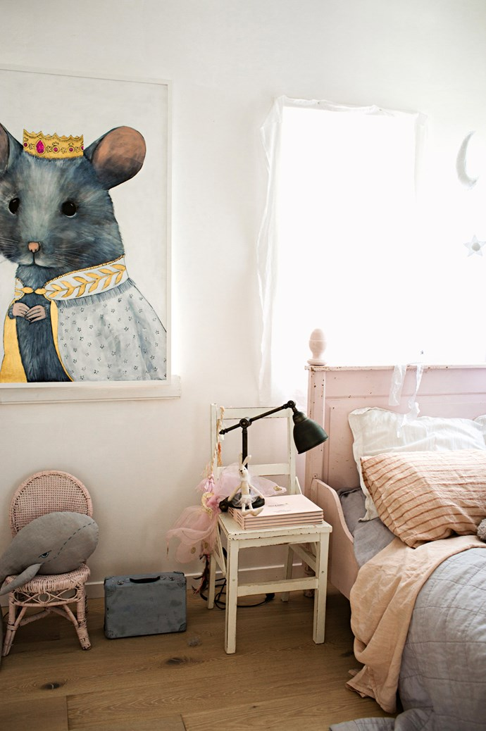 "Artist Cat Lee's Majestic Mia Mouse hangs in one of the children's rooms.  ""I think it's important for children to live in and enjoy a space, but also to learn an appreciation for the things around them,"" says Vicki. ""They can be messy but they still treat everything with care.""  