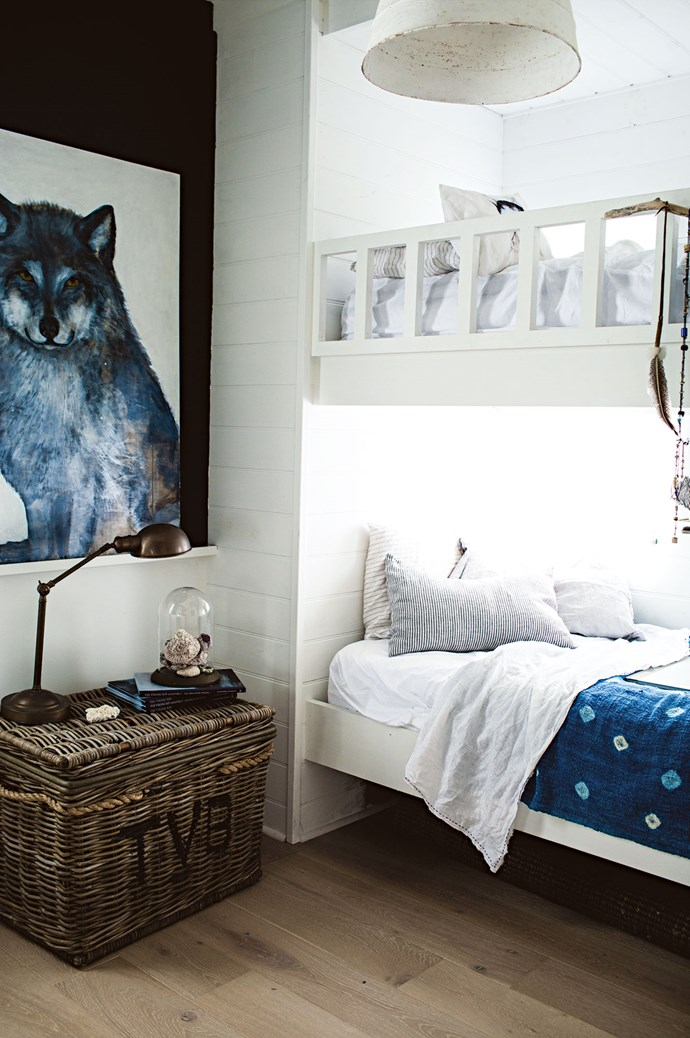 In the second kids' room, Cat Lee's Watchful Wyatt Wolf artwork hangs alongside custom-made bunk beds.  | Photo: Kara Rosenlund