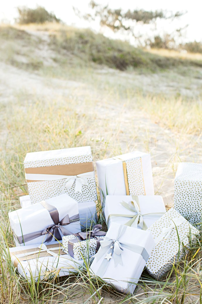 Presents await on the beach for Vicki's family, while other children across the globe receive theirs from the Unclebearskin studio. Meticulously wrapped and sealed with colourful wax, they're always sent with love.    Photo: Kara Rosenlund