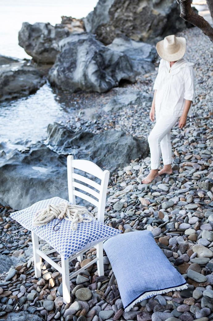 Muted blues by the water's edge. Styling practicums for the Creative Immersion team were sometimes aided by little more than the rugged frame of a rock wall and the stillness of the Aegean Sea.  | Photo: Carla Coulson